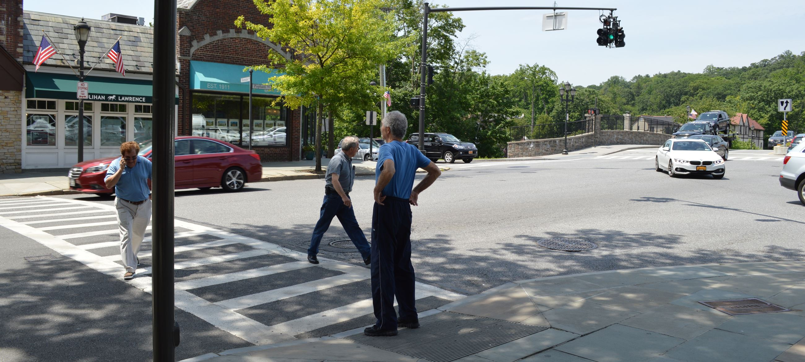 Pedestrians Crossing On green with cell phone (jpg)